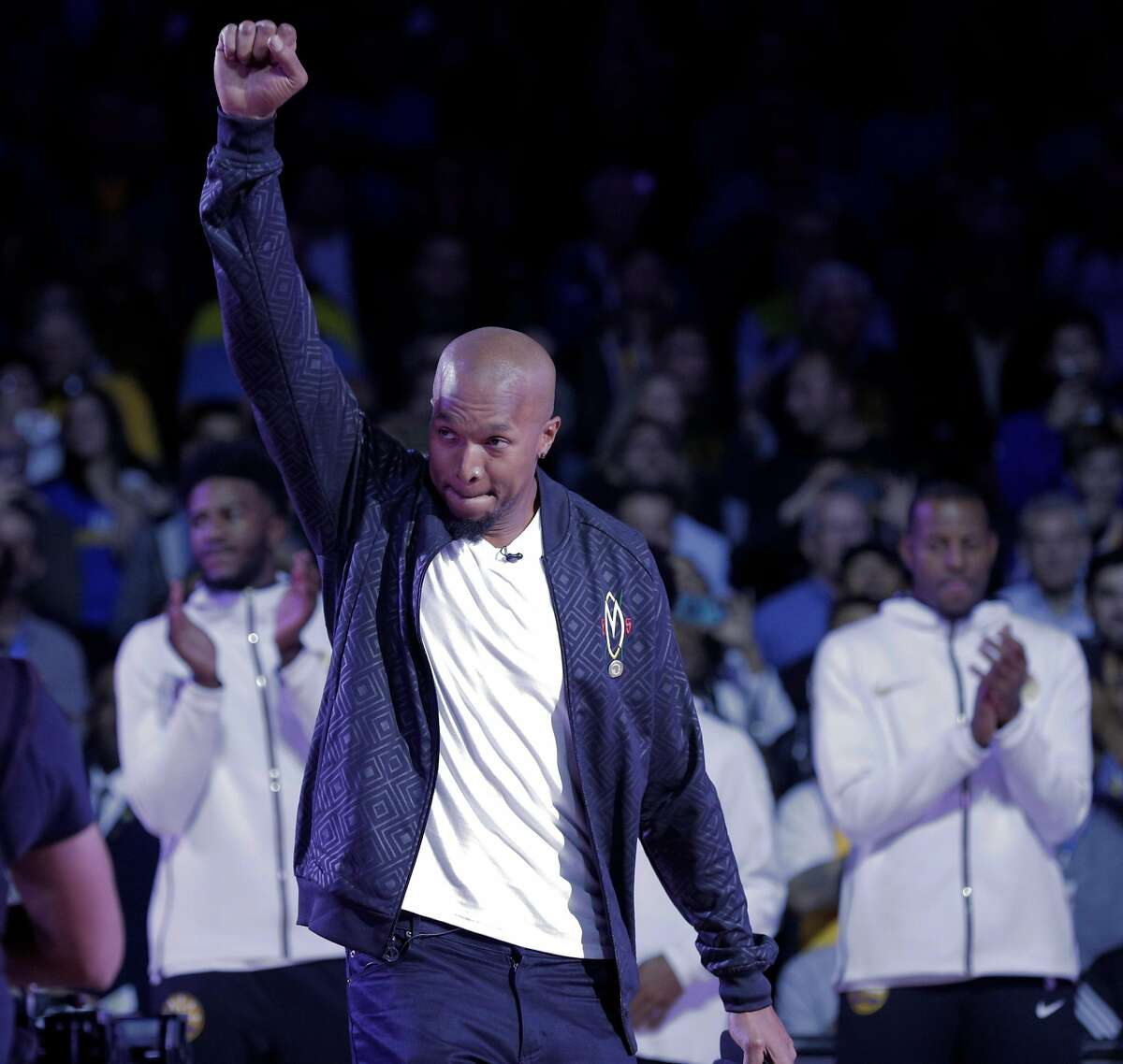 David West gestures as he goes up to recieve his championship ring before the Golden State Warriors played the Oklahoma City Thunder at Oracle Arena in Oakland, Calif., on Tuesday, October 16, 2018. The Warriors received their 2018 NBA Championship rings and saw their championship banner raised in the arena