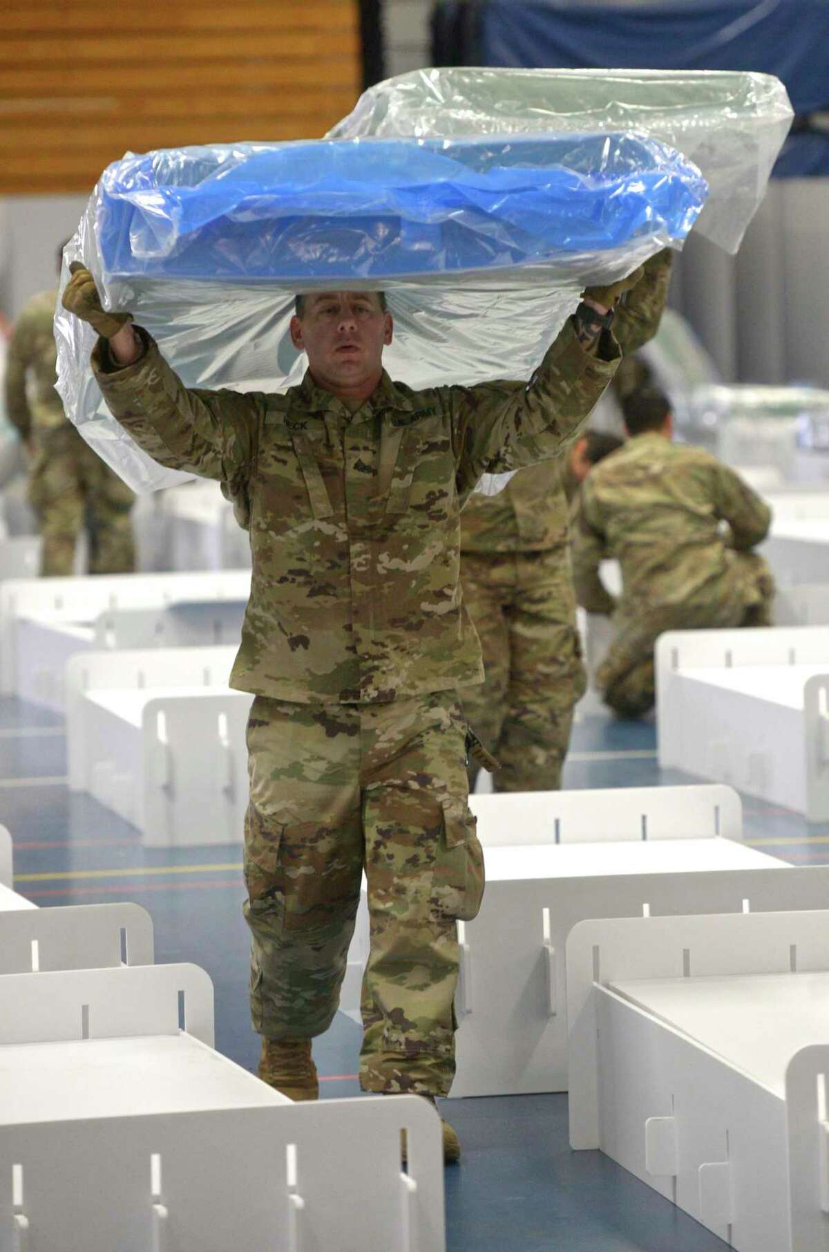 The national guard arrived Wednesday at the O'Neill Center on Western Connecticut State University Westside campus to begin to transform the building into a 219 bed medical space that would be used if area hospitals see a surge in patients. Wednesday, April 1, 2020, in Danbury, Conn.