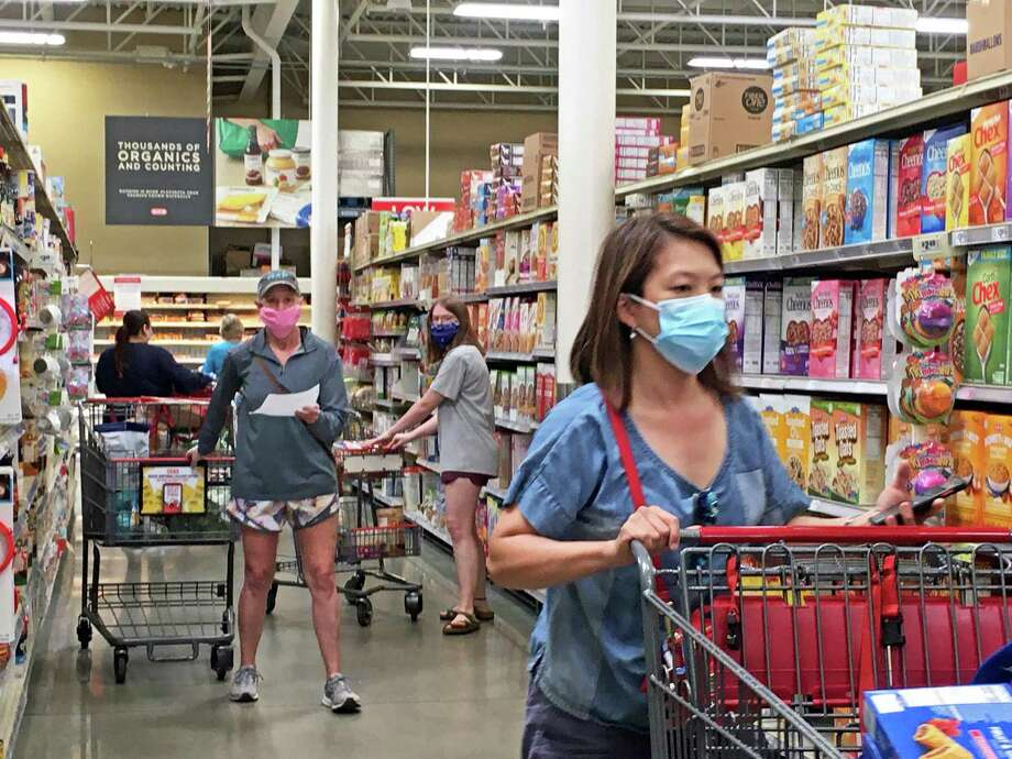 Shoppers at the Sugar Land HEB grocery store on Hwy 6 on Tuesday, April 7, were spotted wearing masks after new recommendations from the Centers for Disease Controll advised wearing a face covering was needed to slow the spread of COVID-19. Photo: Kristi Nix