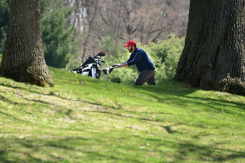 A golfer is seen pushing his golf bag on a cart at Schenectady Municipal Golf Course on Tuesday, April 28, 2020 in Schenectady, N.Y. (Lori Van Buren/Times Union)