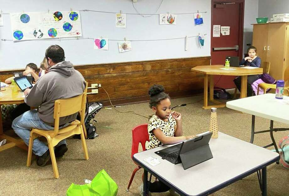 Children enrolled in the Middlesex YMCA emergency child care program in Middletown take part in distance learning over the summer. The YMCA has partnered with the city's elementary schools to offer full-time day care with limited openings. Photo: Contributed Photo