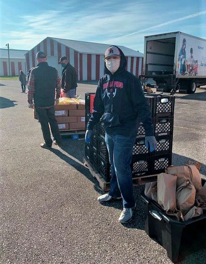 As well as asking guests to remain in their vehicle during the mobile pantry event, volunteers wore face masks as they distributed the bags of food to the cars. (Courtesy photo)