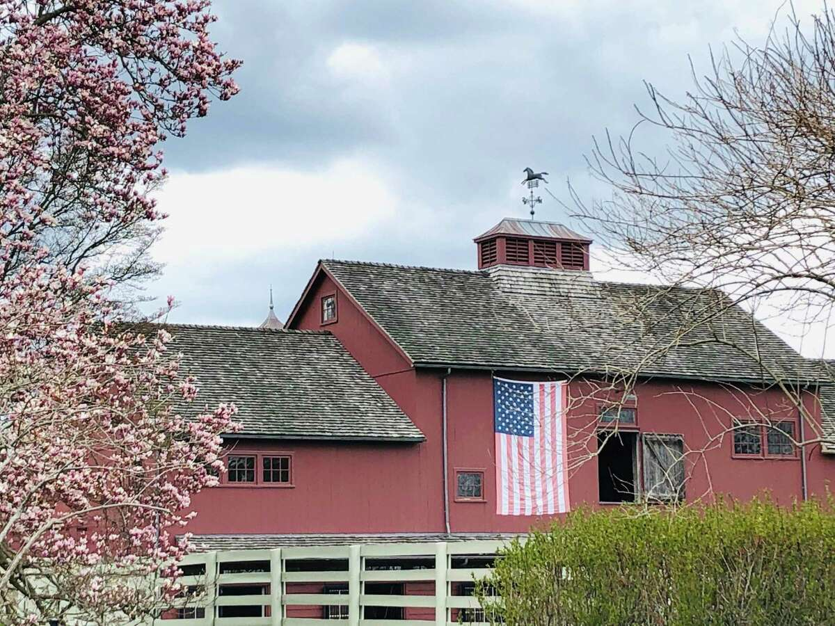 An American flag drapes over a red barn on Vail Lane in North Salem, N.Y.