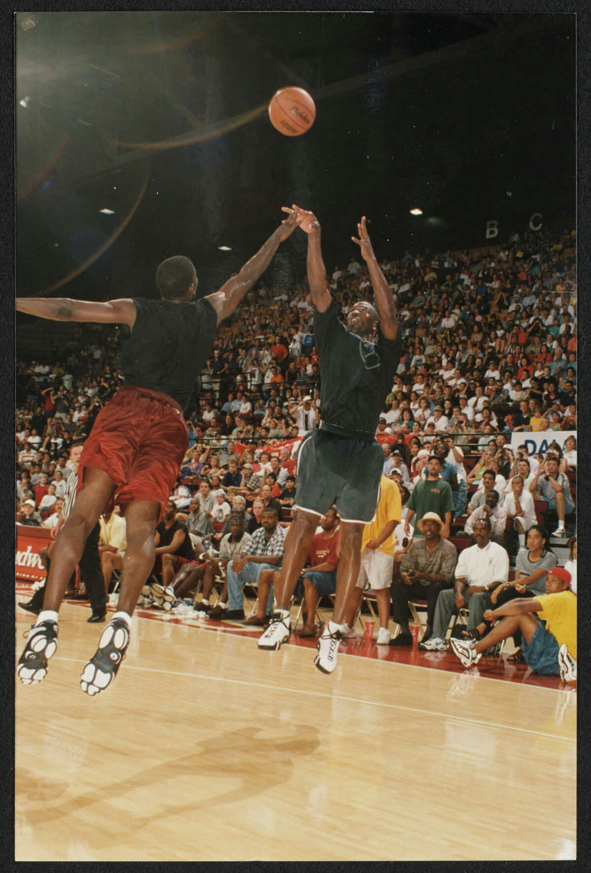 """Texas State University dug into the school's archives to share 22-year-old photos showing Jordan playing at Strahan Coliseum for a charity event. The university shared a few more photos with mySA in addition to those shots that were tweeted over the weekend. The photos show a then 35-year-old Jordan participating in the June 22, 1998, """"Let Me Play"""" camp, golf and basketball event. The series of games started in Austin, but the finale was hosted on the Texas State campus, which was named Southwest Texas State University at the time. About 7,000 people showed up to watch Jordan play, according to the 1999 Pedagog, the school's yearbook."""