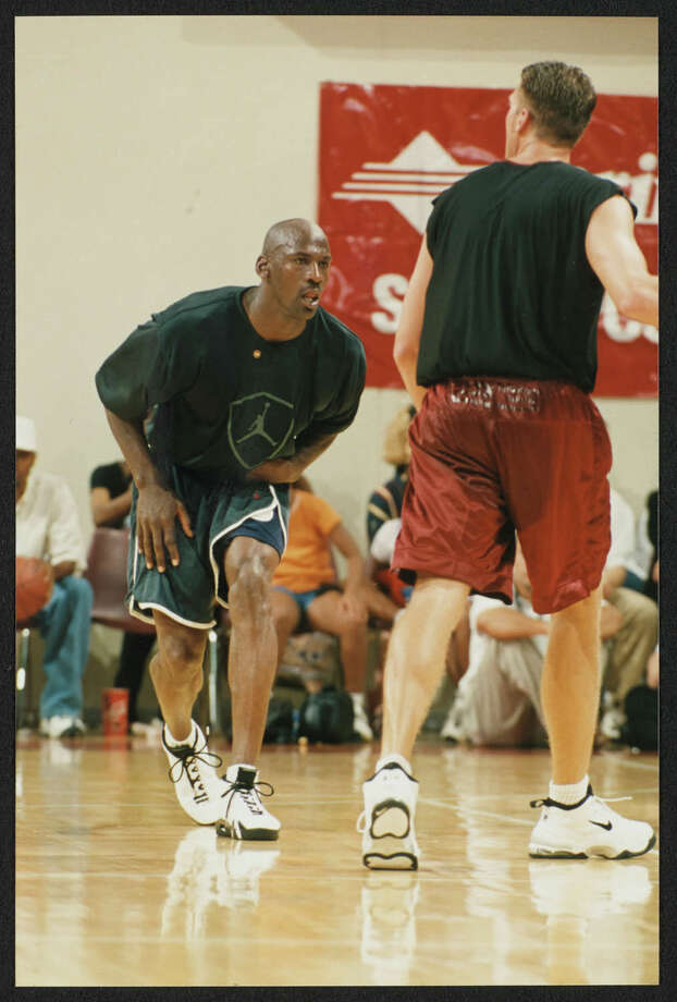 """Texas State University dug into the school's archives to share 22-year-old photos showing Jordan playing at Strahan Coliseum for a charity event. The university shared a few more photos with mySA in addition to those shots that were tweeted over the weekend. The photos show a then 35-year-old Jordan participating in the June 22, 1998, """"Let Me Play"""" camp, golf and basketball event. The series of games started in Austin, but the finale was hosted on the Texas State campus, which was named Southwest Texas State University at the time. About 7,000 people showed up to watch Jordan play, according to the 1999 Pedagog, the school's yearbook. Photo: Courtesy, Reeba Varghese, Texas State University"""