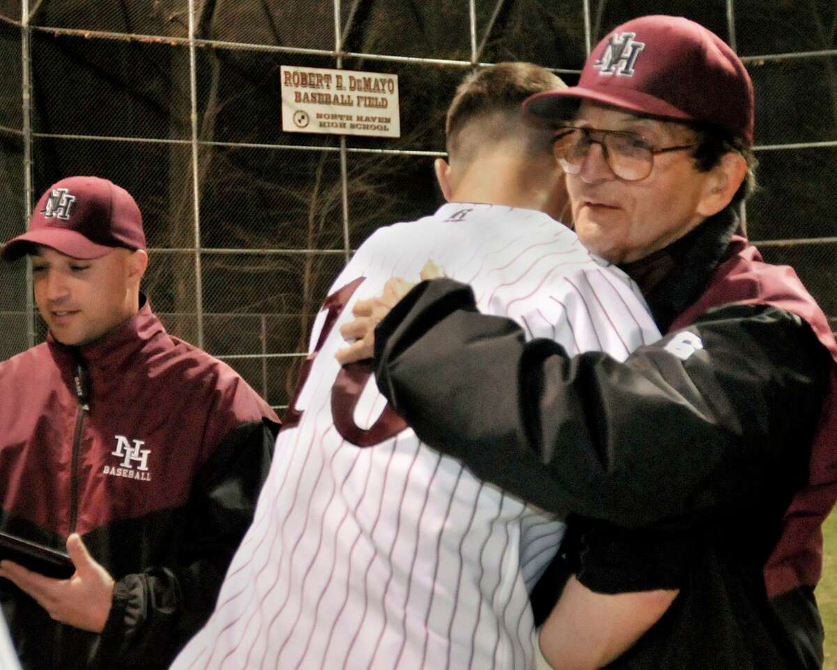 North Haven coach Bob DeMayo is congratulated by his team after his 800th win. He was also presented with a plaque.