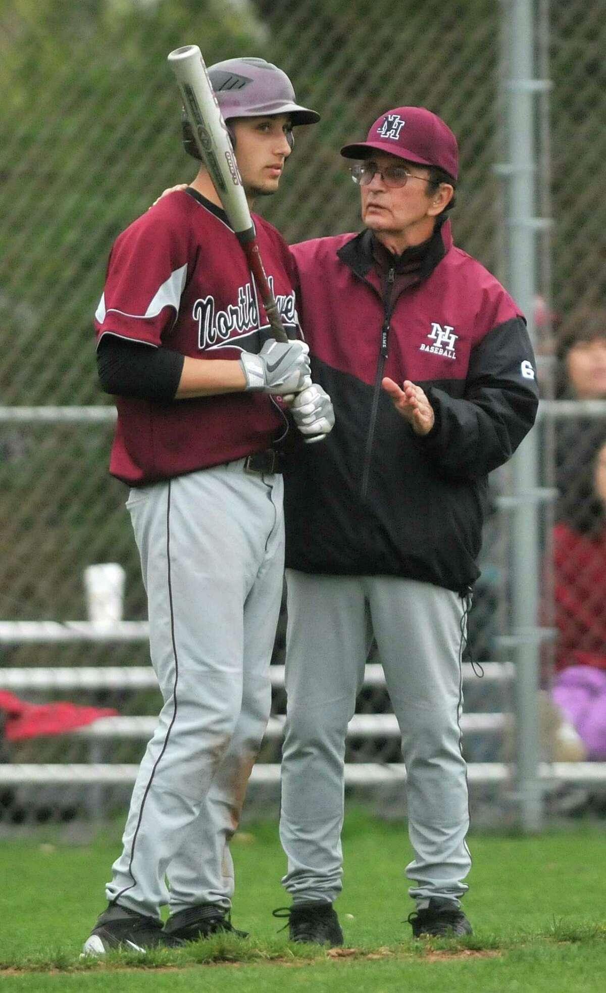 North Haven coach Bob DeMayo, right, speaks to Christian Karnachov in 2011.