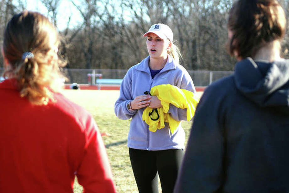 Alton High girls soccer coach Gwen Sabo, center, gives instructions during a practice session in March at AHS. The season was cut short two weeks into practice and a few days before the Redbirds' scheduled first game. Photo: Pete Hayes | The Telegraph
