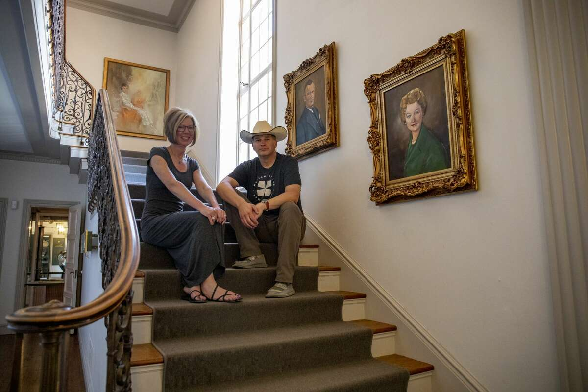 Executive director Dan Eck and director of community engagement Christine Eck pose on the staircase of the Turner Mansion by portraits of Fred Jr. and Juliette Turner on Tuesday, April 28, 2020 at the Museum of the Southwest.