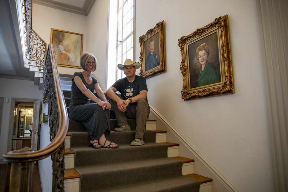 Executive director Dan Eck and director of community engagement Christine Eck pose on the staircase of the Turner Mansion by portraits of Fred Jr. and Juliette Turner on Tuesday, April 28, 2020 at the Museum of the Southwest. Photo: Jacy Lewis/Reporter Telegram