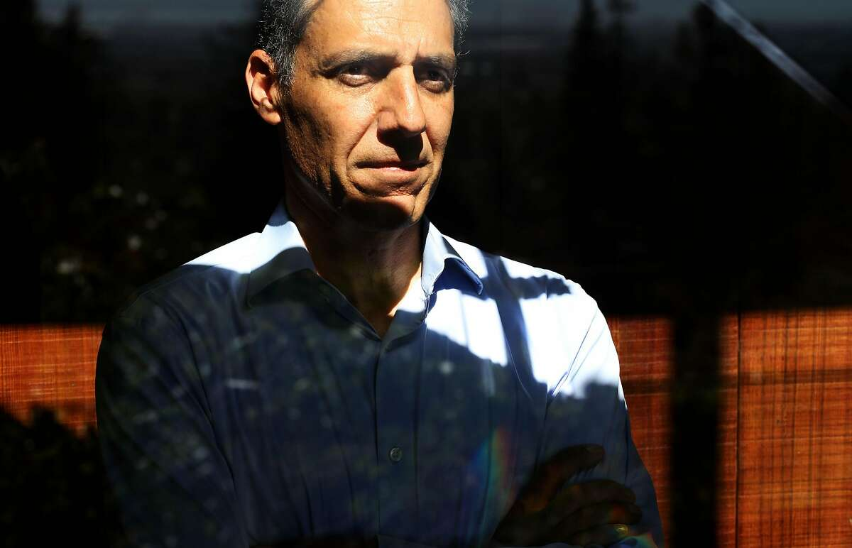 Professor Hany Farid poses for a portrait in his home on Wednesday, April 22, 2020, in Berkeley, Calif. Prof. Farid is doing a huge survey related to conspiracies and the coronavirus. He's done work with Facebook and Twitter in the past to combat this kind of thing.