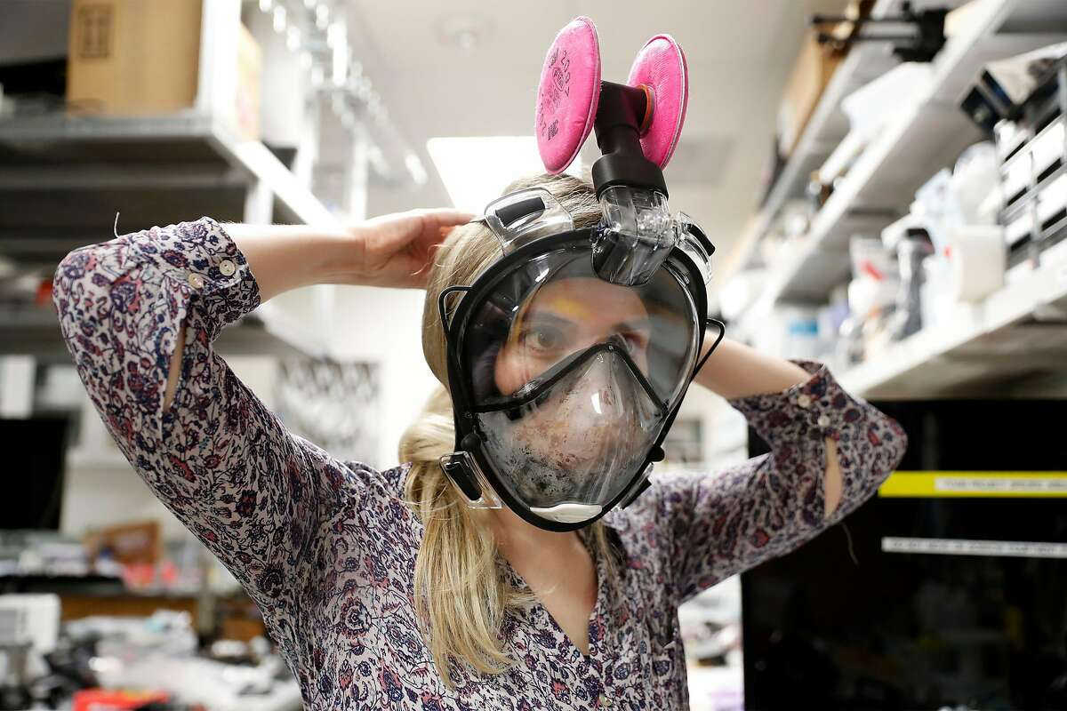 Student Laurel Anne Kroo tests a medical mask made out of snorkel gear in the Shriram Center at Stanford University.