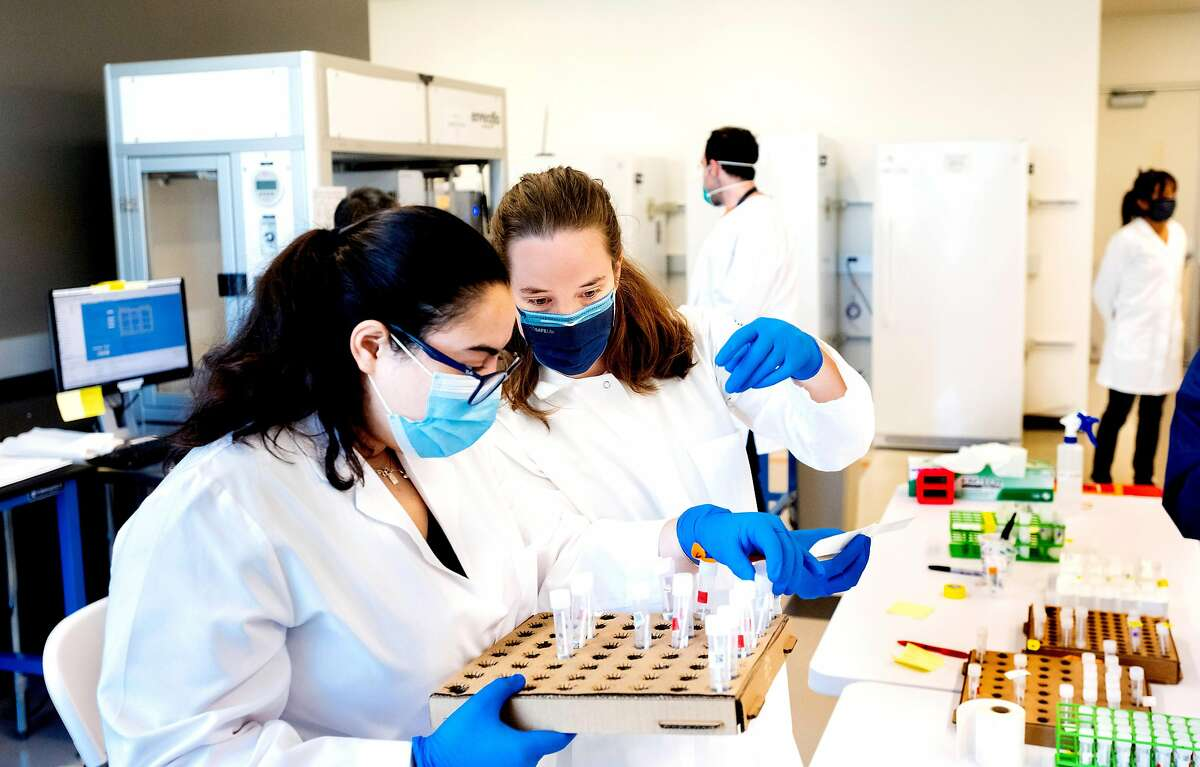 UCSF scientists Valentina Garcia, right, and Paula Serpa process COVID-19 test samples at a new UCSF diagnostic laboratory adjacent to the Chan Zuckerberg Biohub (CZ Biohub) on Friday, April 24, 2020, in San Francisco. (Photo by Noah Berger)