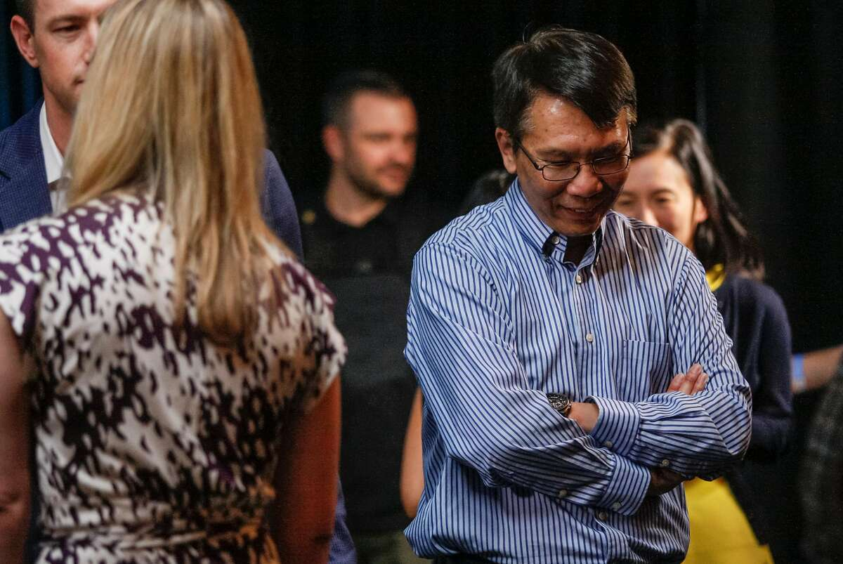 Thuan Pham, CTO at Uber, chats with colleagues and friends, Wednesday, June 3, 2015, at the Uber headquarters in San Francisco, Calif. The company's CEO Travis Kalanick gave a speech at Uber's five-year anniversary event.