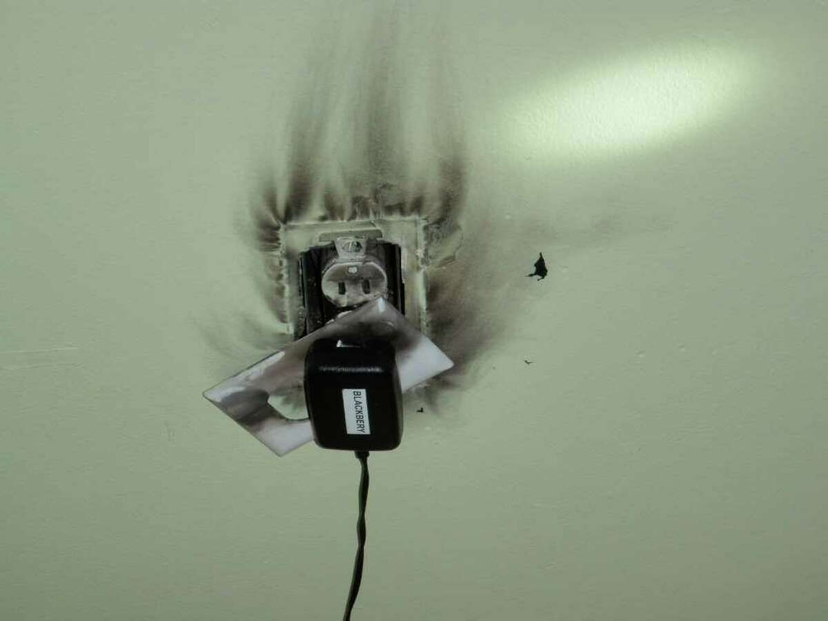 This electrical wall outlet caught fire Friday afternoon in a Greens Farms Road home.