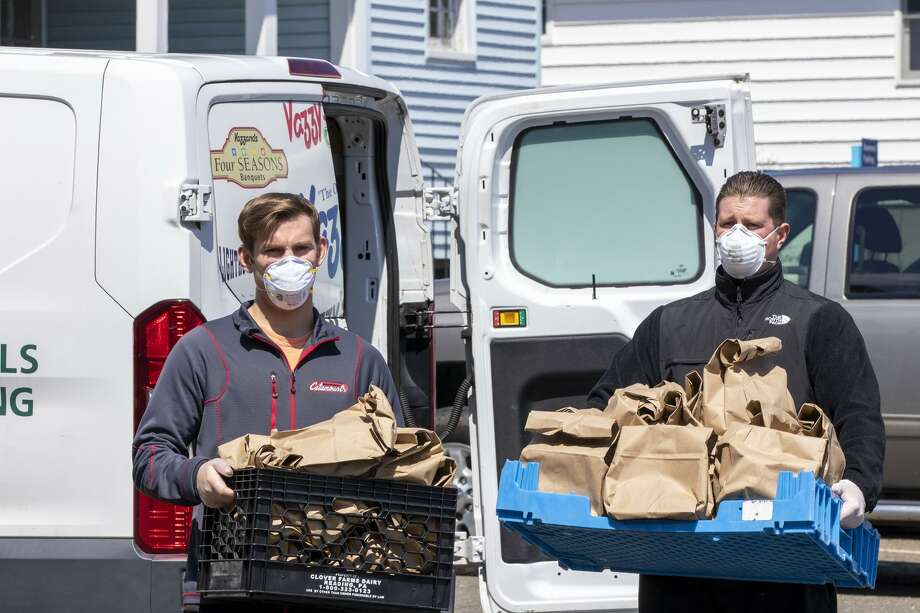 Vazzy's employees drop off food at Bridgeport Hospital. Photo: / Fairfield College Preperatory School