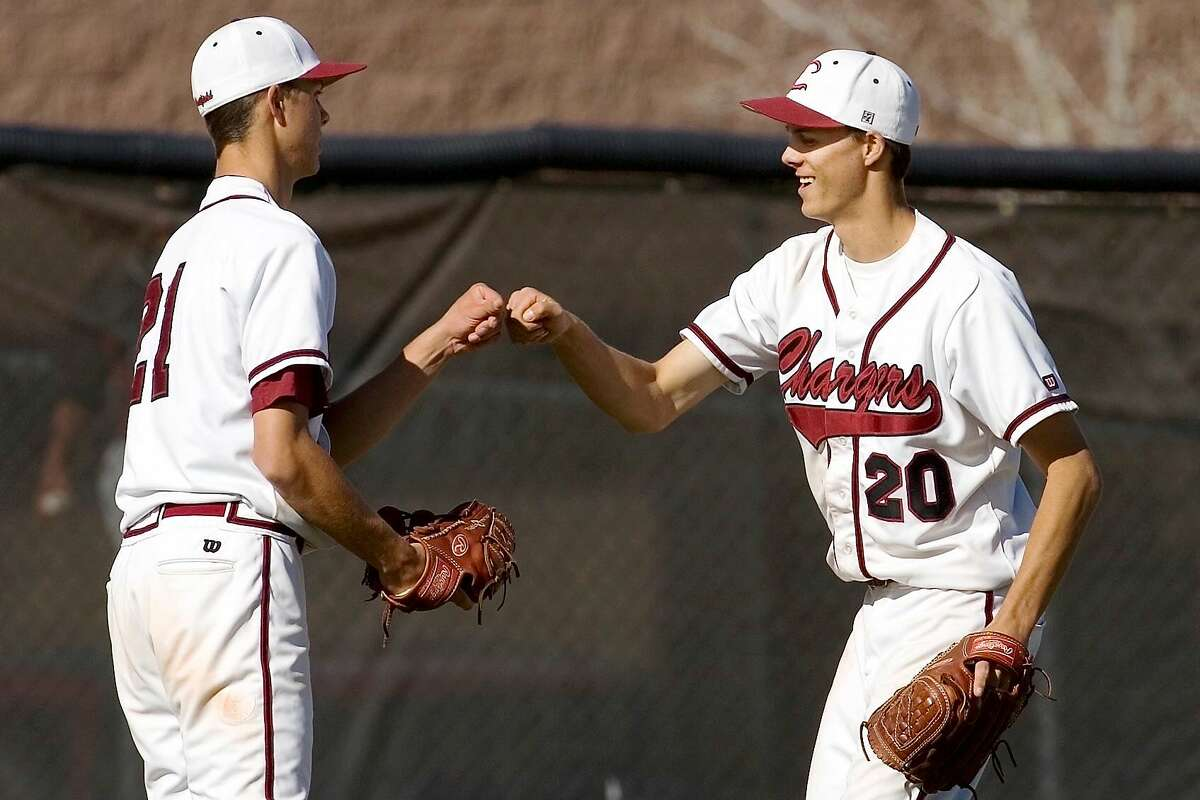 Tyler and Taylor Rogers bump fists after a high school game in Colorado.