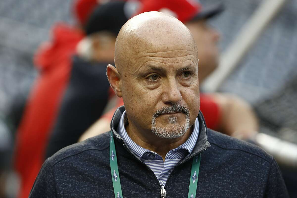 """FILE - In this Oct. 26, 2019, file photo, Washington Nationals general manager Mike Rizzo watches batting practice for Game 4 against the Houston Astros in the baseball World Series in Washington. """"The challenges have been that they stopped playing baseball about six weeks into the spring season,"""" Rizzo said, talking about the draft. """"So that's been the biggest hurdle that we had to face. Fortunately, we dive into this draft thing very, very seriously. We got a lot done early on, especially the higher-round type of premier prospects. We have a really good feel of what's out there in the country."""" (AP Photo/Patrick Semansky, File)"""