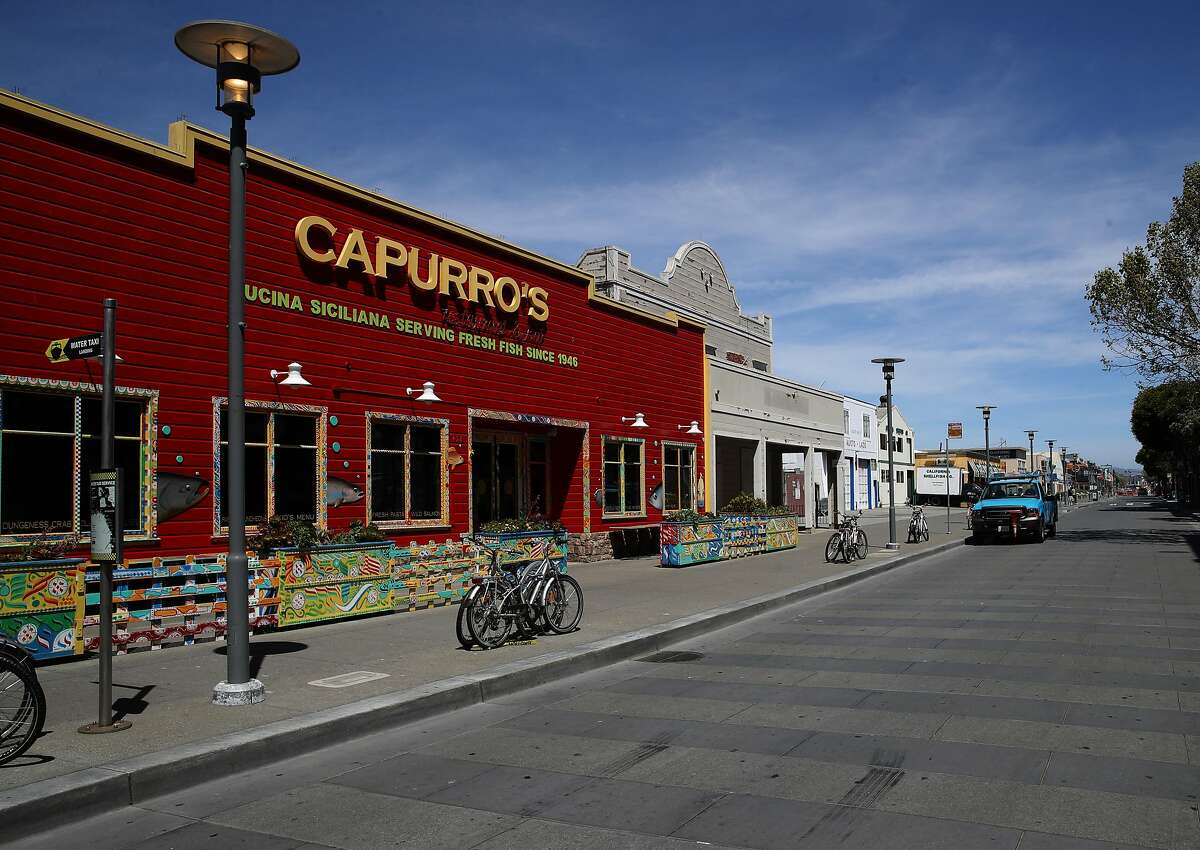 SAN FRANCISCO, CALIFORNIA - APRIL 27: Jefferson Street in the Fisherman's Wharf tourist destination sits empty on April 27, 2020 in San Francisco, California. Officials from several counties in the San Francisco Bay Area have extended the coronavirus (COVID-19) shelter in place order through May. (Photo by Justin Sullivan/Getty Images)