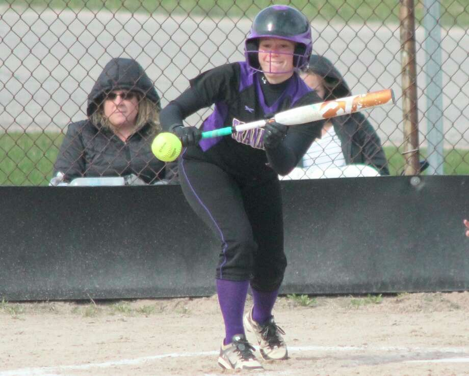 Kassidy Hollenbeck squares to punt during a 2019 home softball game. (File photo)