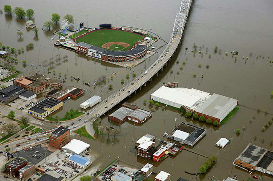 An aerial photo of Davenport, Iowa, shows Modern Woodmen Park and the surrounding area covered by Mississippi River floodwaters.The floodplain awaiting this year's surge is part of a changing picture, altered from just a few decades ago. It is now dotted with more parks, marshes and forests on land surrendered in recent years by communities and people. Photo: Kevin E. Schmidt | Quad City Times (AP)