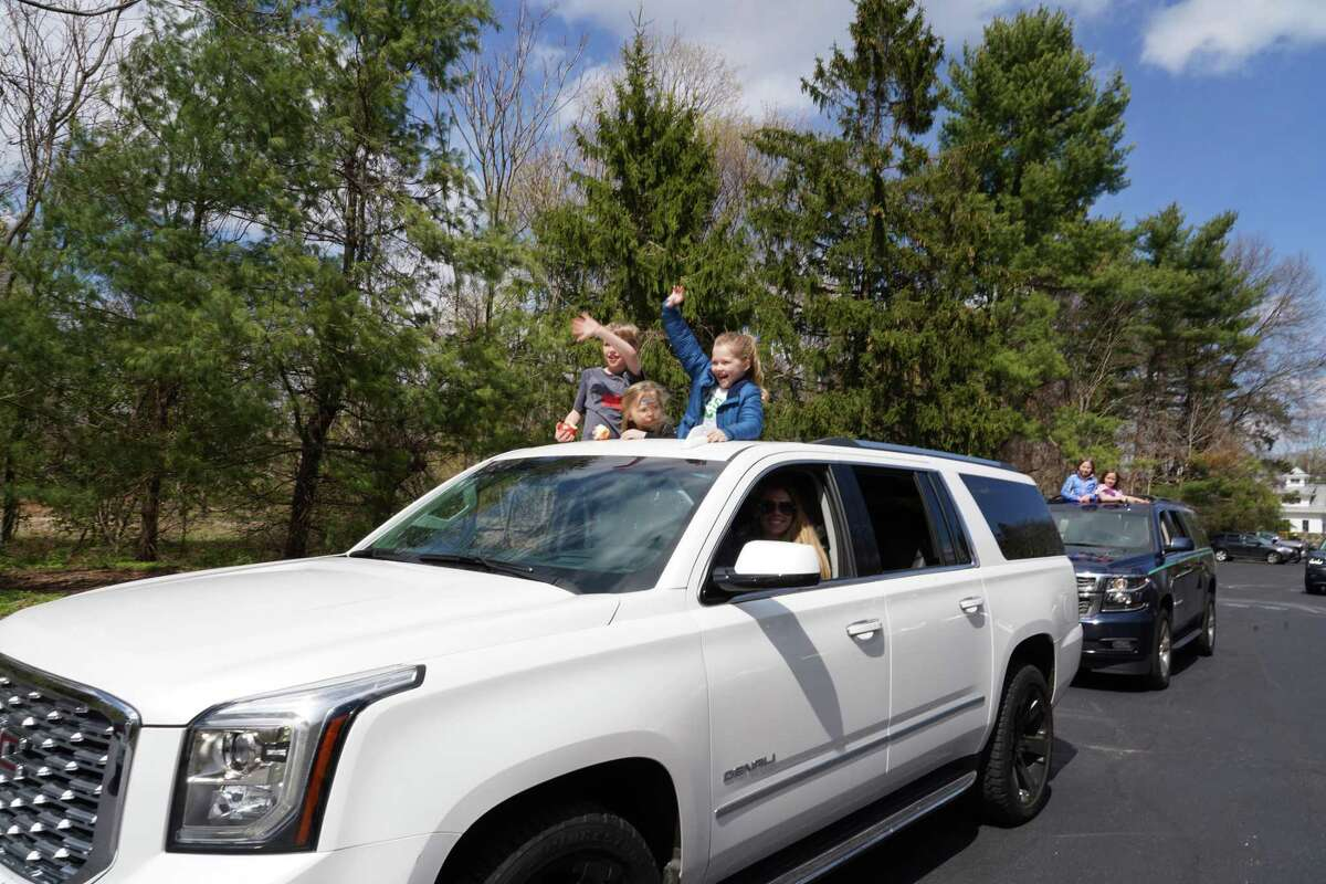 Children at the First Presbyterian Nursery School just had to get a peek at their teachers during a drive-by event held at the school recently. The car is being driven by Parent and Board Member Erin Marich. The children in the sunroof are Ben, Lucy and Hadley Marich.