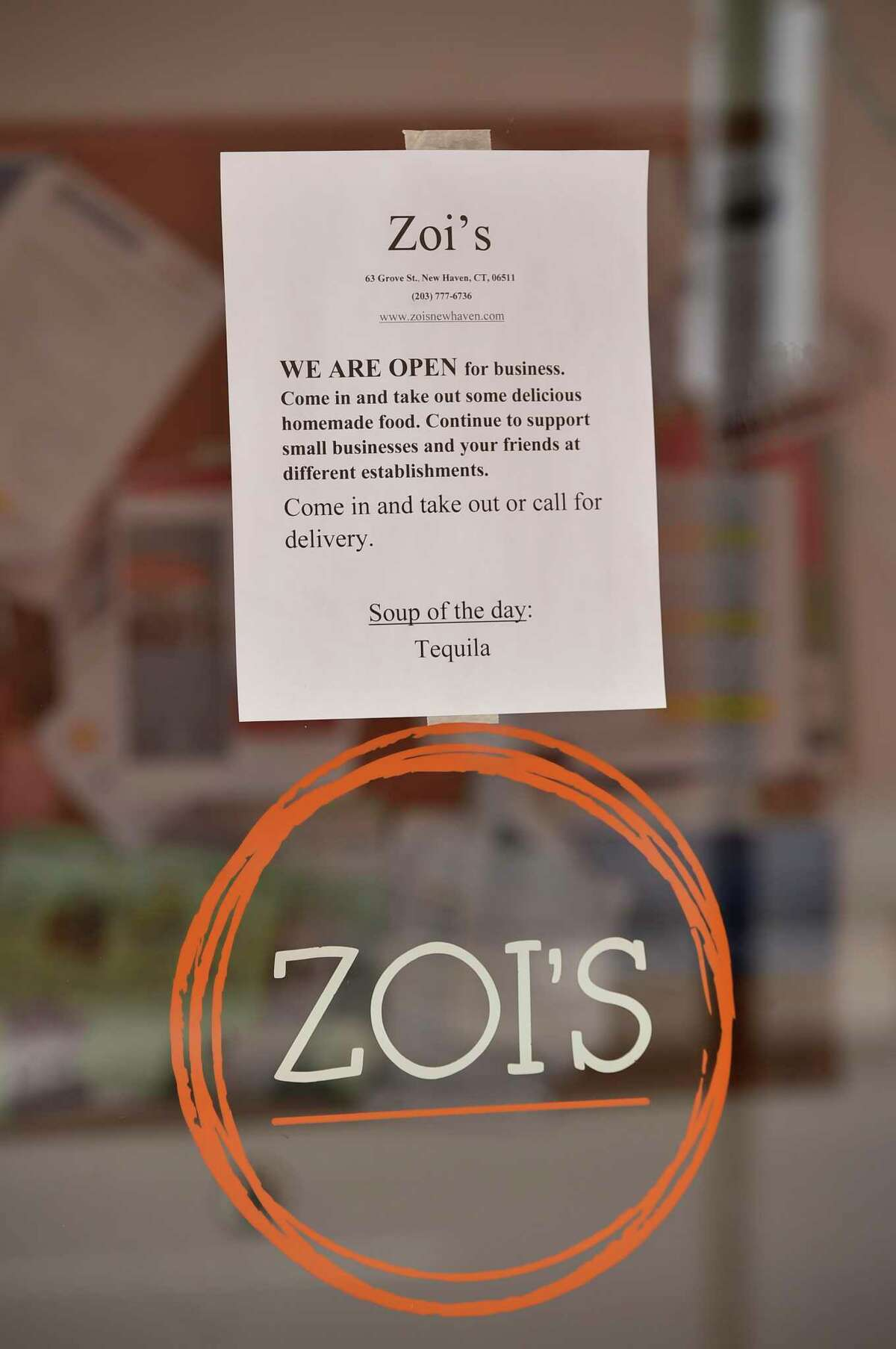 A notice in March on the front door of Zoi's, a breakfast, lunch and catering service restaurant in New Haven, encouraging patrons to take out their food during the pandemic.