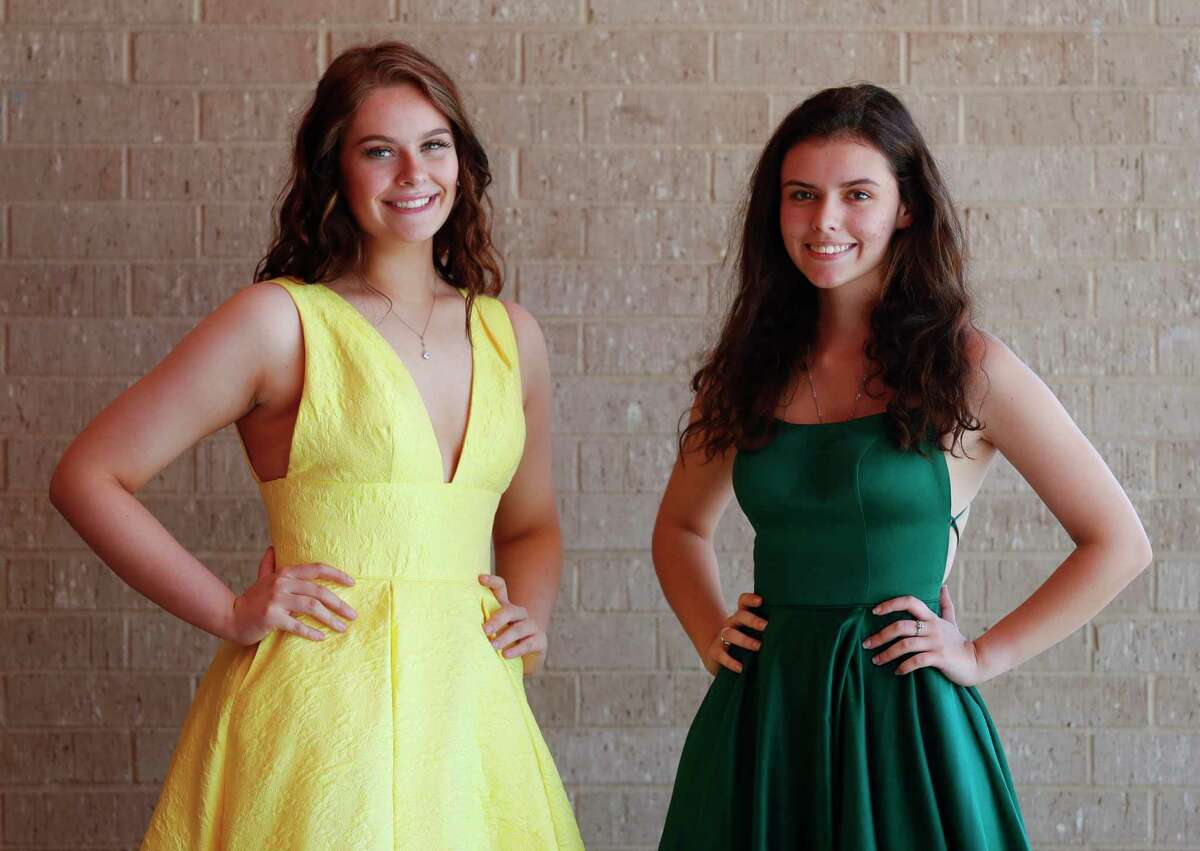 Oak Ridge seniors Alexandra Jackson, left, and Madison Washburn pose for a portrait in the dresses they would have worn to prom at Oak Ridge High School, Friday, April 24, 2020, in Oak Ridge.