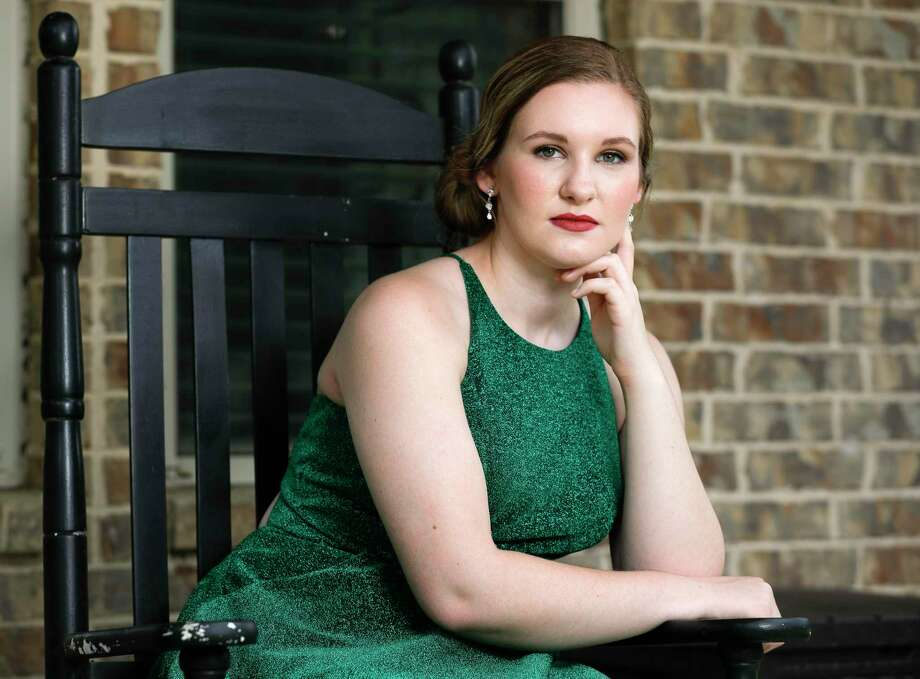 Oak Ridge High School senior Emma Baskin poses for a portrait in the dress she would have worn to the school's prom, Tuesday, April 7, 2020, in Willis. Photo: Jason Fochtman, Houston Chronicle / Staff Photographer / 2020 © Houston Chronicle
