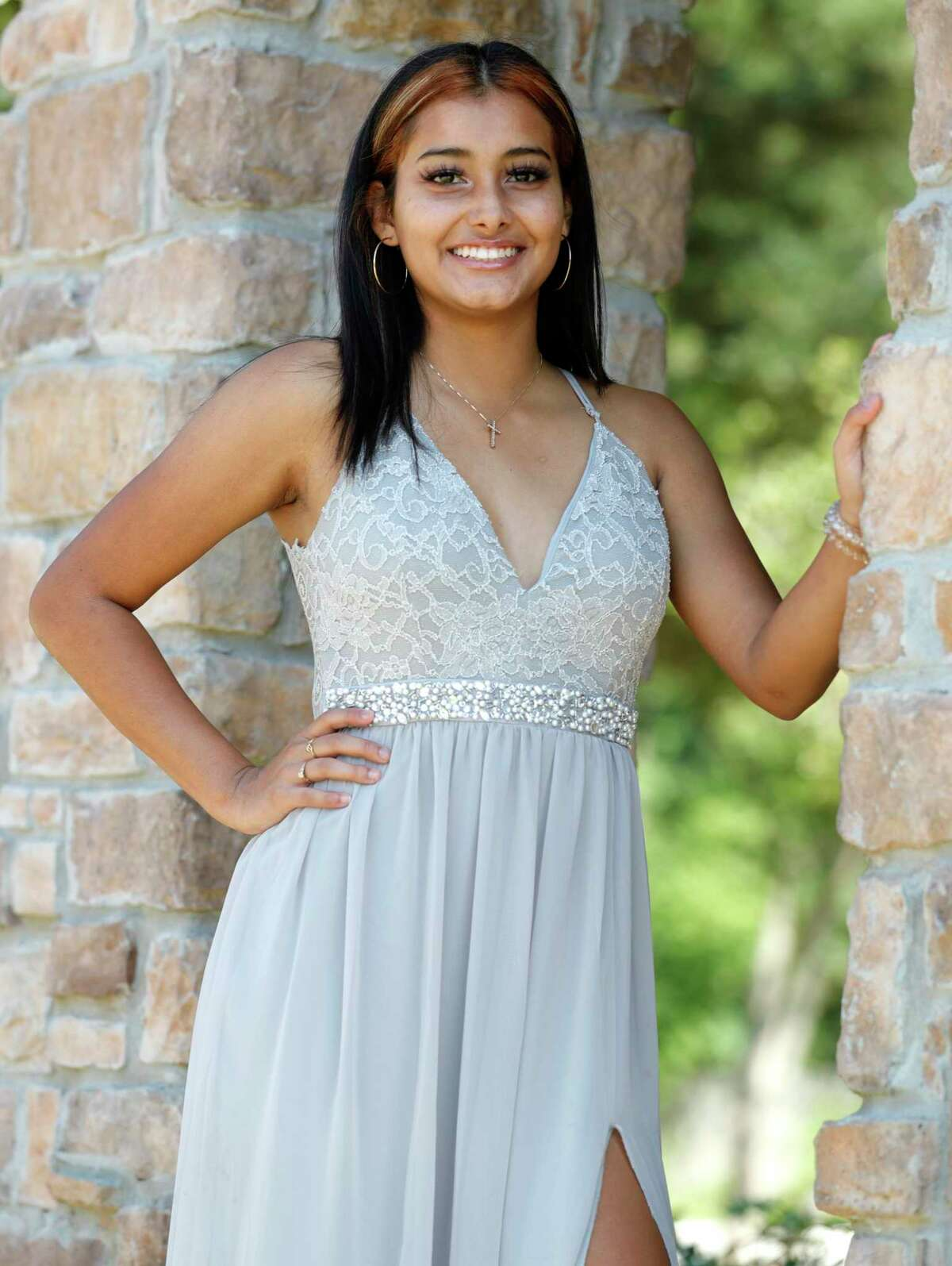 College Park senior Mariana Cortes poses for a portrait in the dress she would have worn to prom, Friday, April 24, 2020, in Spring.