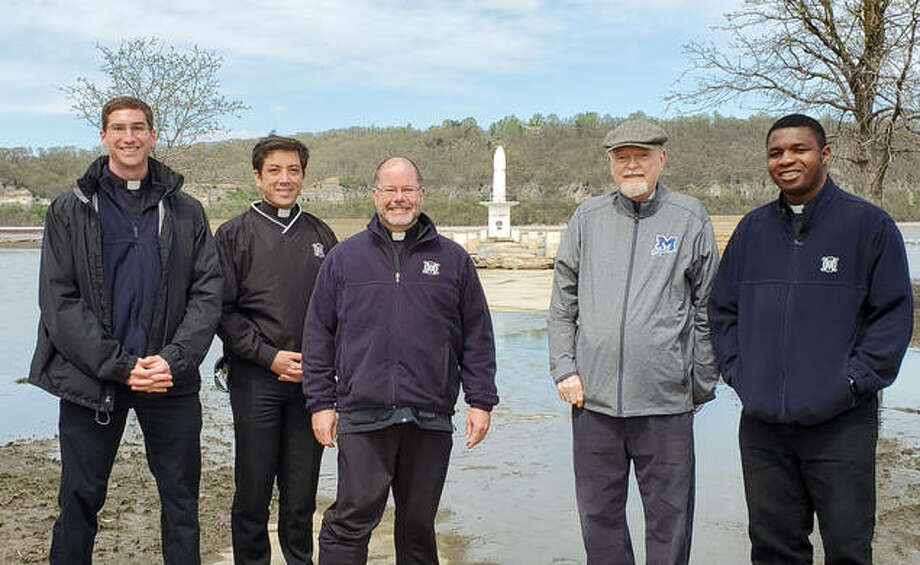 "Local Catholic clergy are encouraging parishioners to pray to Our Lady of the Rivers ""to protect us from the rising waters of contagion."" Pictured April 13 at the shrine in Portage des Sioux, Missouri are Brother Leland Thorpe, Father Paul Nguyen, Father Jeremy Paulin, Father David Beauregard and Father Ben Unachukwu."