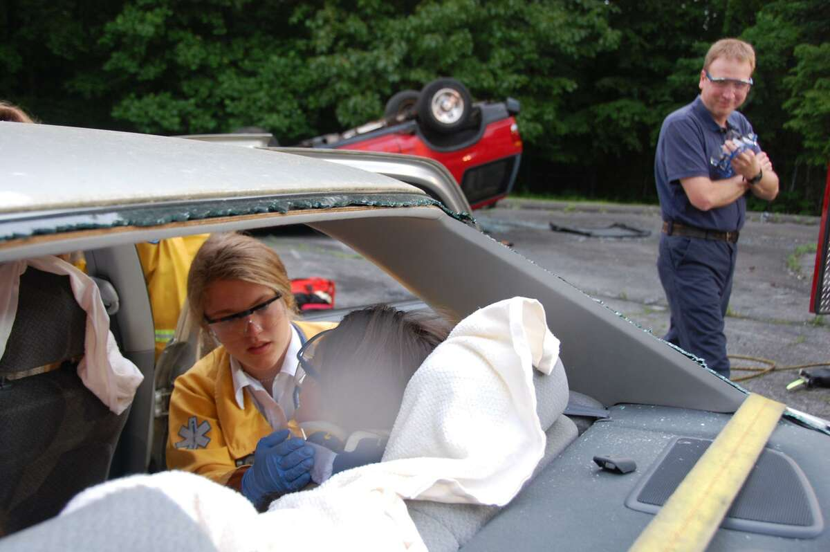 Lucie Edwards, a volunteer with Darien EMS-Post 53, during an EMT class extrication drill.