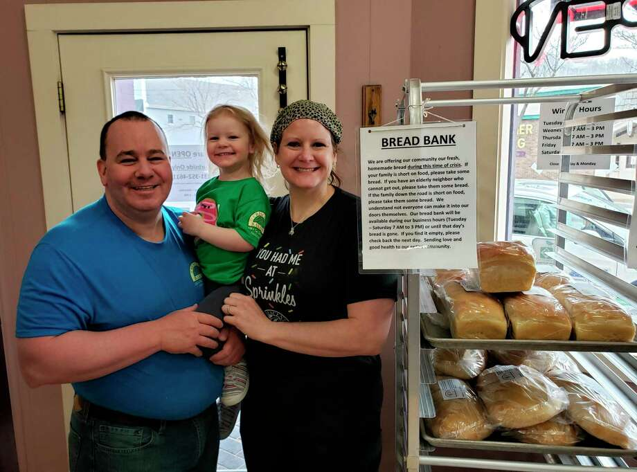 The Crescent Bakery began offering free, baked fresh daily bread to those in need of food, free of charge, before any stay at home orders were put in place. Pictured isAdreon and Healther Kiplinger, owners of the bakery, with their daughter, Ellie. (Courtesy Photo)