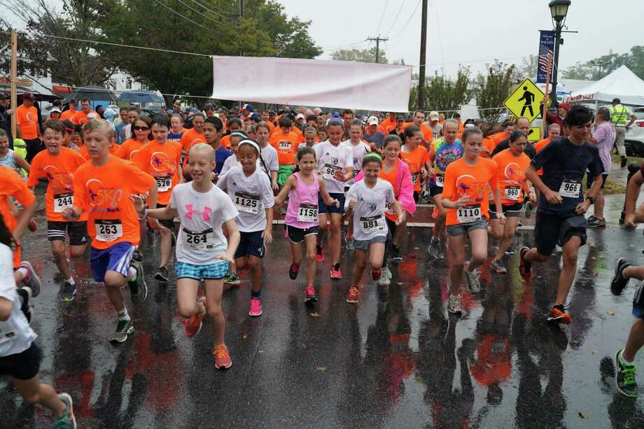 A rainy start never put a damper on the Circle of Care 5K. This year's race will be a virtual one due to the COVID-19 pandemic. Photo: Jeff Salguero / Circle Of Care / Wilton Bulletin Contributed