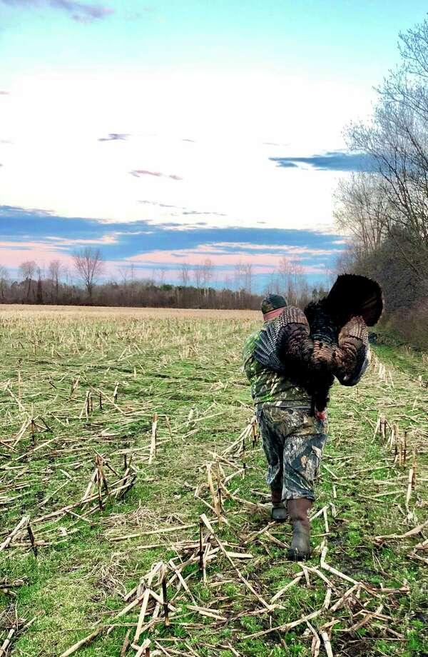 Author Ryan Soulard leaves a farmer's field after a successful turkey hunt. (Courtesy Photo)