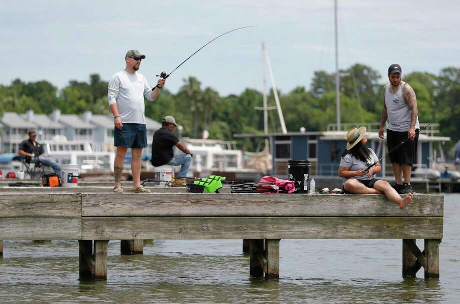 People fish off boat docks on Lake Conroe, Saturday, April 25, 2020, in Conroe. Photo: Jason Fochtman, Houston Chronicle / Staff Photographer / 2020 © Houston Chronicle