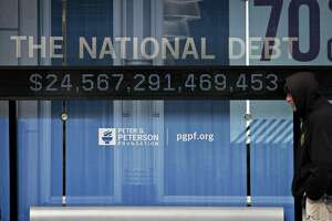 A national debt counter ticks upward in Washington.   Looking past the hypocrisy of politicians, should we be worried about the effects of COVID-19 on debt? No.