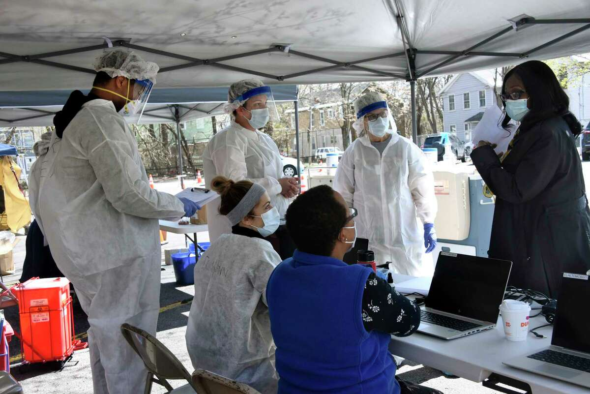 Leslyn Williamson, chief operating officer/chief nursing officer Ellis Medicine, right, talks to health care workers at a coronavirus testing site at the Washington Irving Education Center on Wednesday, Tuesday, April 29, 2020 in Schenectady, N.Y. (Lori Van Buren/Times Union)