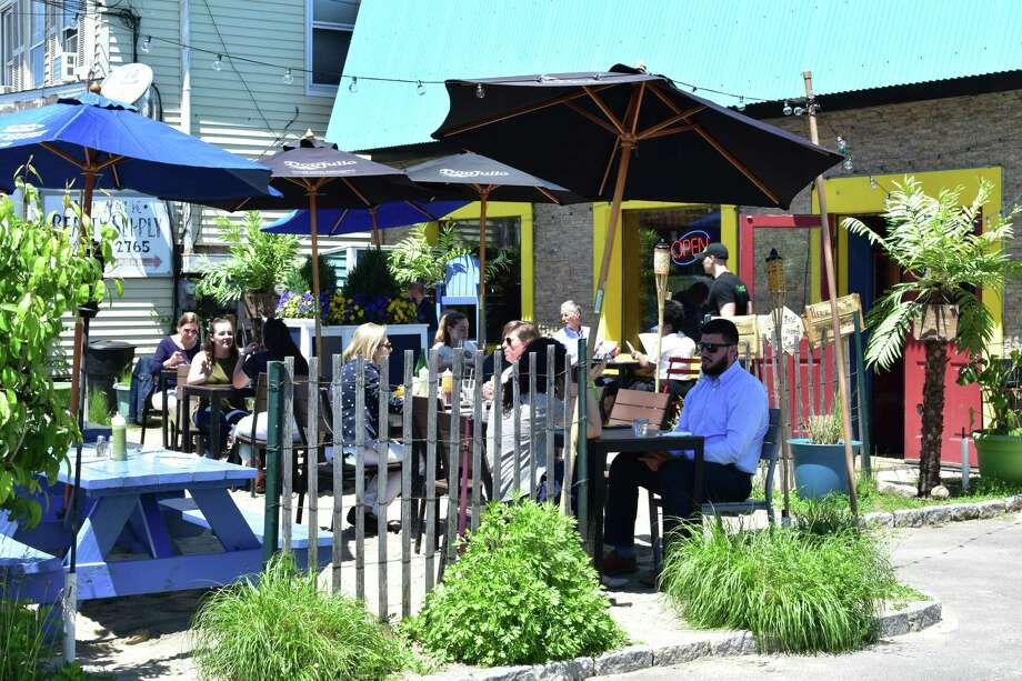 Diners enjoy a sunny noon hour in May 2018, at the outdoor patio of Valencia Luncheria on Main Street in Norwalk, Conn. Photo: Alexander Soule / Hearst Connecticut Media / Stamford Advocate