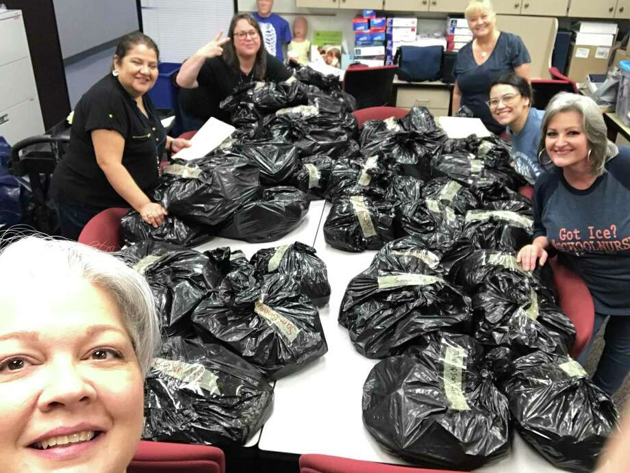 Pasadena ISD nurses sort through eyeglasses that they distributed to students during the novel coronavirus pandemic through See2Succeed, a program to provide children with free eye exams and glasses. Working on the project are Kathy Ashworth, left, Ninfa Cedillo, Shannon Rogers, Janet Hatch, Carla Reyes and Kim Harvell. Photo: Courtesy Pasadena ISD