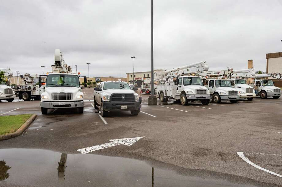 About a dozen trucks from Volt Power stage in the Parkdale Mall parking lot. They were just released from the tornado-ravaged area around Onalaska  and were called in by Entergy to deal with power outages in the Jefferson County area caused by last night's storm. Photo made on April 29, 2020. Fran Ruchalski/The Enterprise Photo: Fran Ruchalski, The Enterprise / © 2020 The Beaumont Enterprise