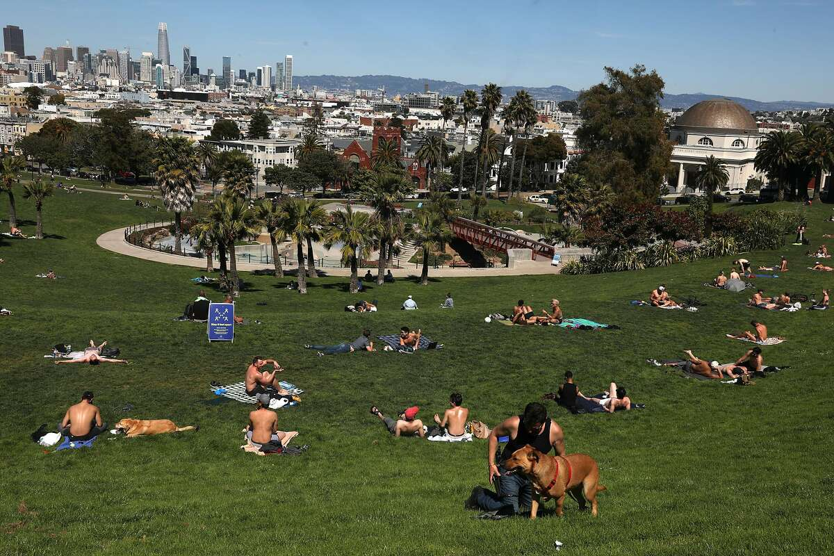 Numerous sunbathers at Dolores park today but they seem to be distancing on Tuesday, April 14, 2020, in San Francisco, Calif.