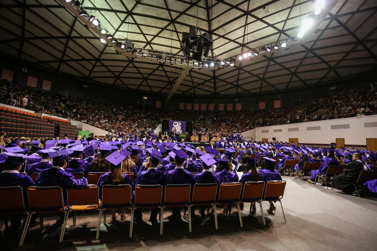 Graduates cross the stage to receive their diplomas during the Willis High School commencement ceremony on Friday, May 26, 2017, at Sam Houston State University.