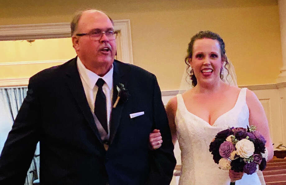 Ron Williams walks his daughter Kali up the aisle on her wedding day, Jan. 18, 2020. Photo: Photo Provided