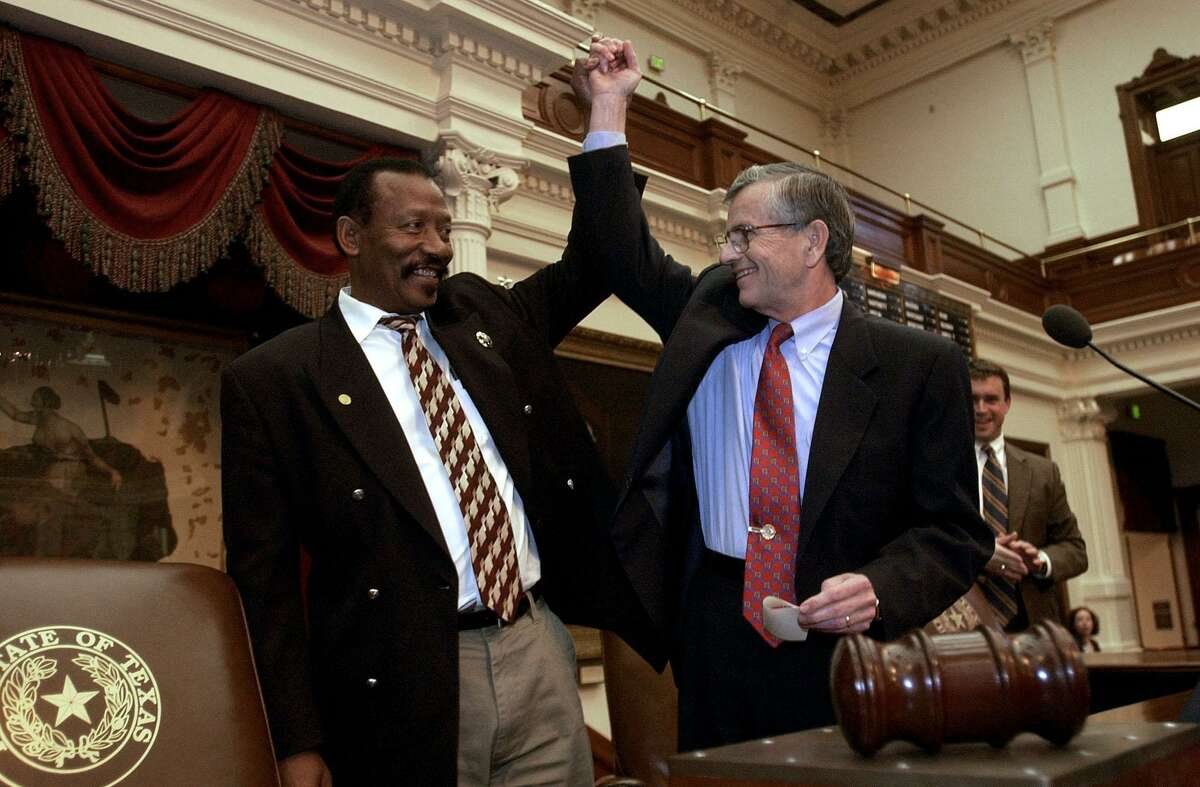Rep. Al Edwards, D-Houston, raises the arm of House Speaker Tom Craddick in victory after the close the 2003 session of the Texas House at the Capitol in Austin, Texas, Monday, June 2, 2003. CHRISTOBAL PEREZ/HOUSTON CHRONICLE. HOUCHRON CAPTION