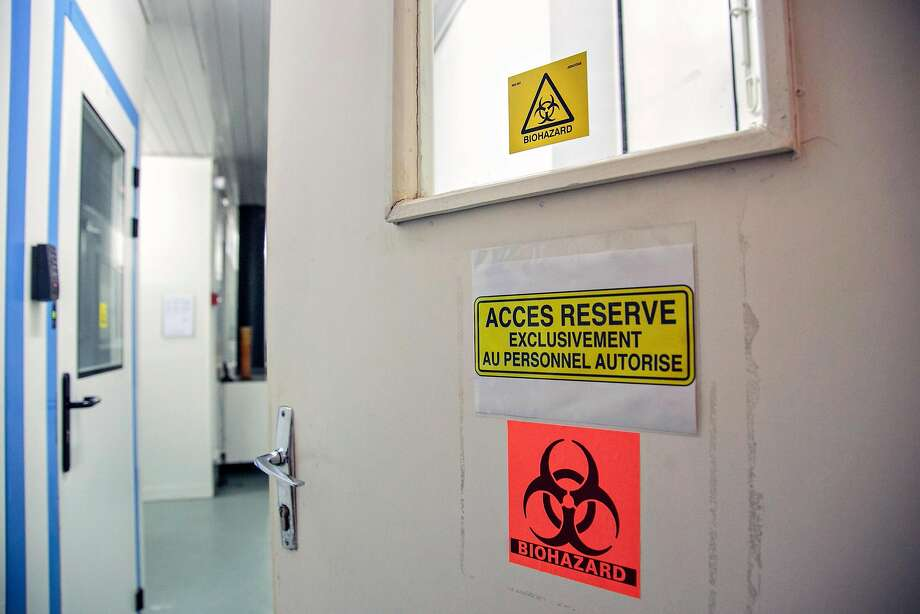 Entrance to a highly secure room at the Pasteur Institute where the world's deadliest viruses of recent years are stored and which are used for vaccine research. Since mid-March, Institut Pasteur, which has partnered with UCSF and Mount Sinai in a major coronavirus research effort, has tested 2,300 patients for COVID-19. Each test requires four hours to process. Photo: Rijasolo / AFP / Getty Images