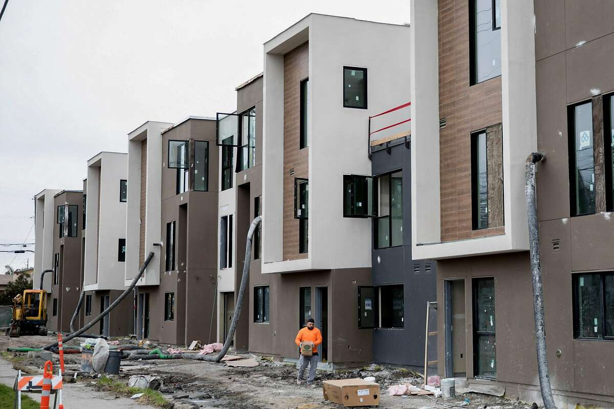 A large mixed-use complex in its final stages of construction is seen on the corner of San Pablo Avenue and Jones Street in Berkeley, Calif. Thursday, February 13, 2020. Berkeley, a city long resistant to housing, is now home to a building boom, and with lots more on the way if economics allow.