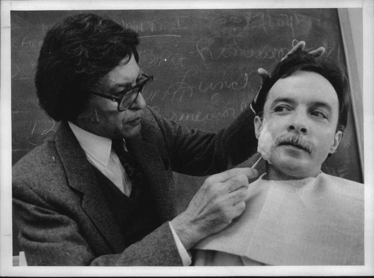Education Opportunity Center, Troy, New York - NBC chief makeup artist Lee Bavnan applies gelatin and cotton batten to the face of EOC cosmetology student Patrick Lanigan during a lecture to the class Monday. The makeup is used to make bumps, wounds, etc. such as cauliflower ears. April 30, 1990 (Dennis J. Michalski/Times Union Archive)