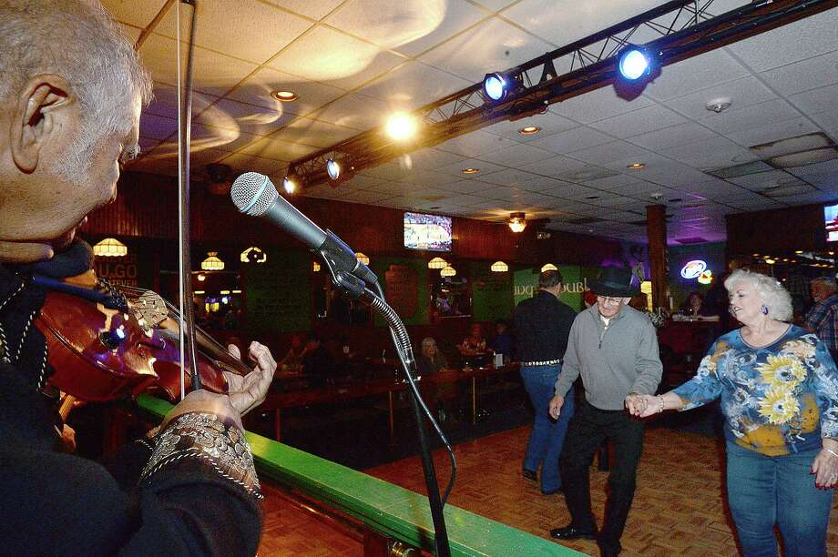 Couples dance to the classic country music of Godwin and Co. Thursday night at Mackenzie's Pub in Beaumont. Godwin's classical country - western tunes are popular with older dancers, who find modern, pop takes on the genre out of step with traditional dancing.  Photo taken Thursday, January 11, 2018 Kim Brent/The Enterprise Photo: Kim Brent / Kim Brent/The Enterprise / BEN