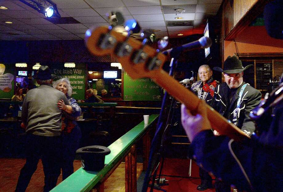 Couples dance to the classic country music of Godwin and Co. Thursday night at Mackenzie's Pub in Beaumont. Godwin's classical country - western tunes are popular with older dancers, who find modern, pop takes on the genre out of step with traditional dancing.  Photo taken Thursday, January 11, 2018 Kim Brent/The Enterprise Photo: Kim Brent / Beaumont Enterprise / BEN